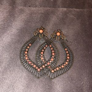 Fun shaped earrings with orange accent